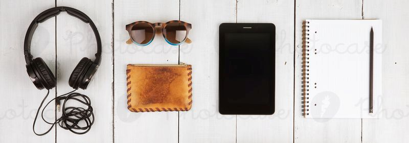 2299667-travel-concept-tablet-pc-headphones-camera-shoes-photocase-stock-photo-large