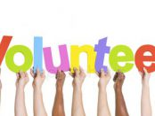 depositphotos_63075279-stock-photo-hands-holding-the-word-volunteer